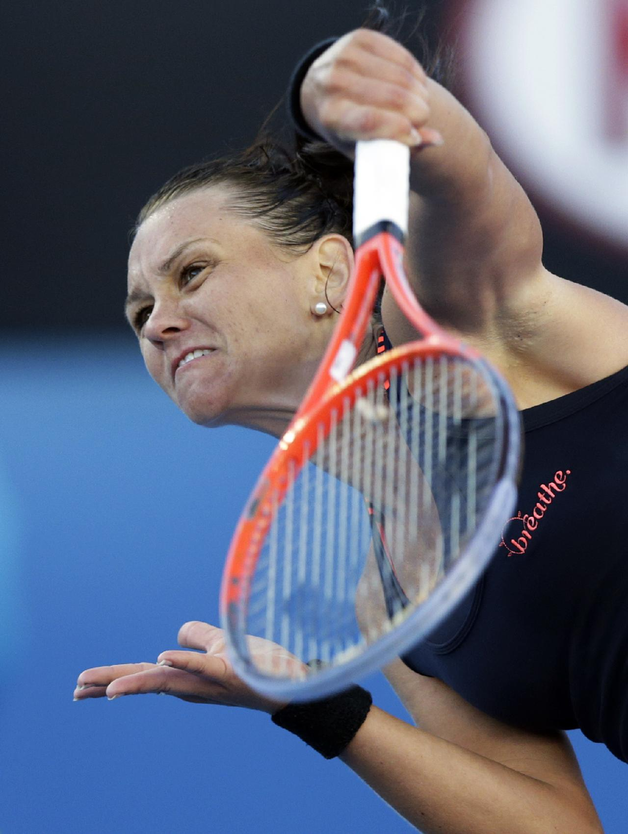 Australia's Casey Dellacqua serves during her first round match against Madison Keys, of the United States, at the Australian Open tennis championship in Melbourne, Australia, Monday, Jan. 14, 2013