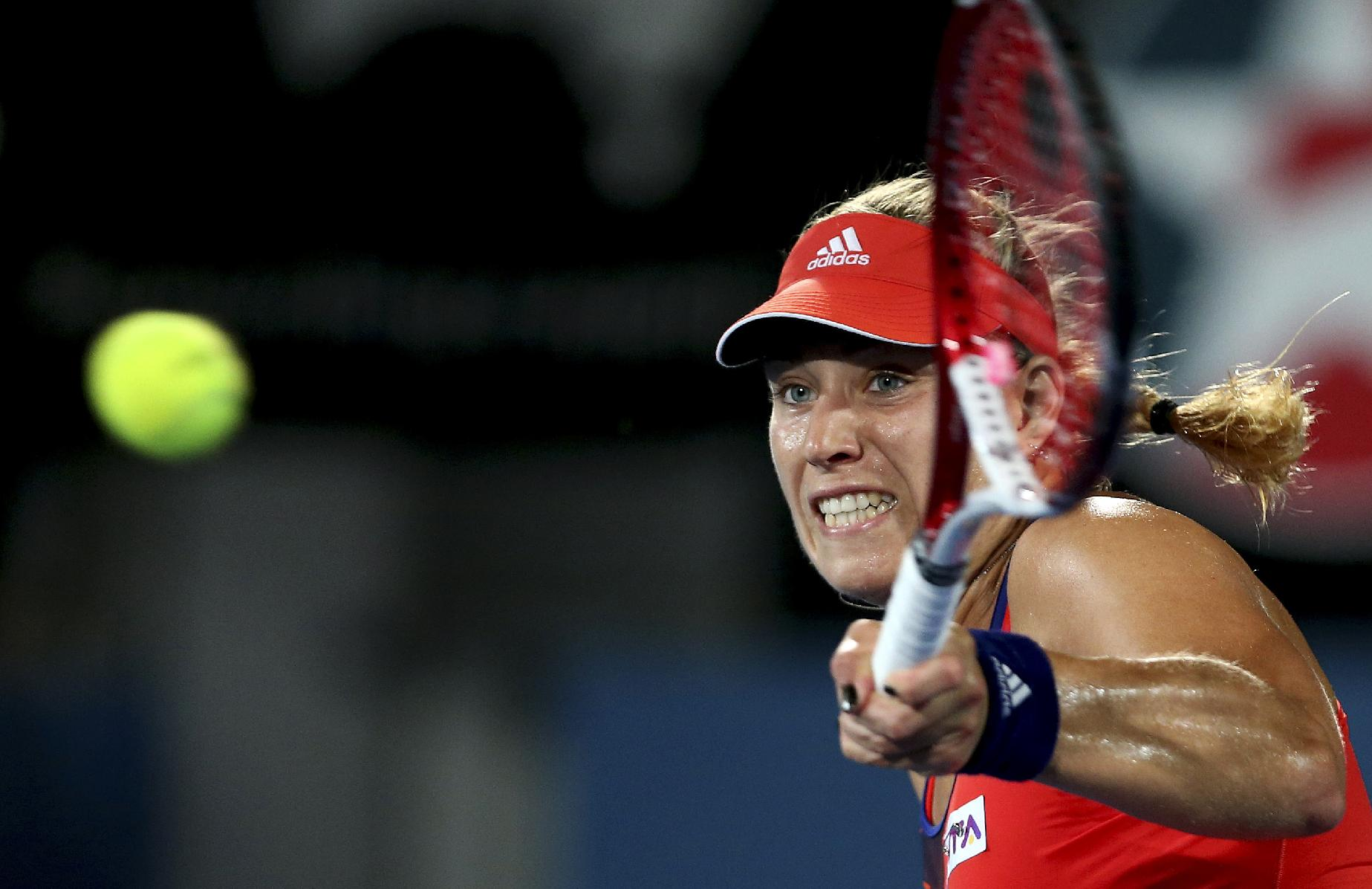 Angelique Kerber of Germany plays a forehand shot in her match against Carla Suarez Navarro of Spain during the Sydney International tennis tournament in Sydney, Australia, Wednesday, Jan. 8, 2014
