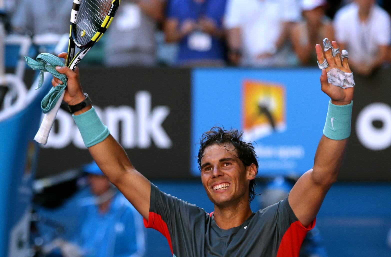 Rafael Nadal of Spain celebrates after defeating Grigor Dimitrov of Bulgaria during their quarterfinal at the Australian Open tennis championship in Melbourne, Australia, Wednesday, Jan. 22, 2014