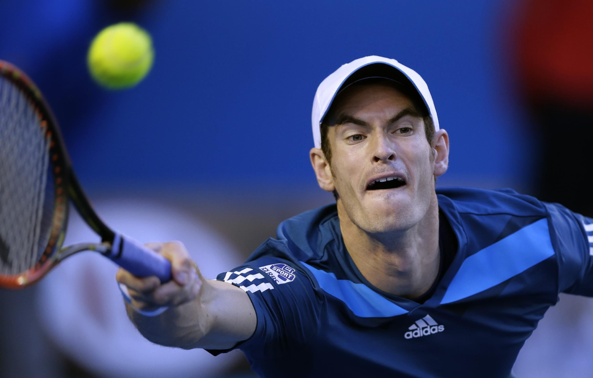 Andy Murray of Britain makes a forehand return to Roger Federer of Switzerland during their quarterfinal at the Australian Open tennis championship in Melbourne, Australia, Wednesday, Jan. 22, 2014