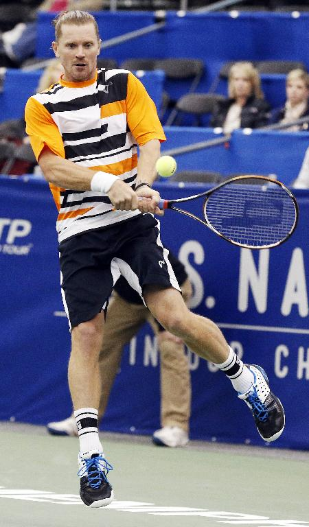 Alex Bogomolov Jr., of Russia, hits a return to Ryan Harrison in the second round match at the U.S. National Indoor Tennis Championships on Wednesday, Feb. 12, 2014, in Memphis, Tenn
