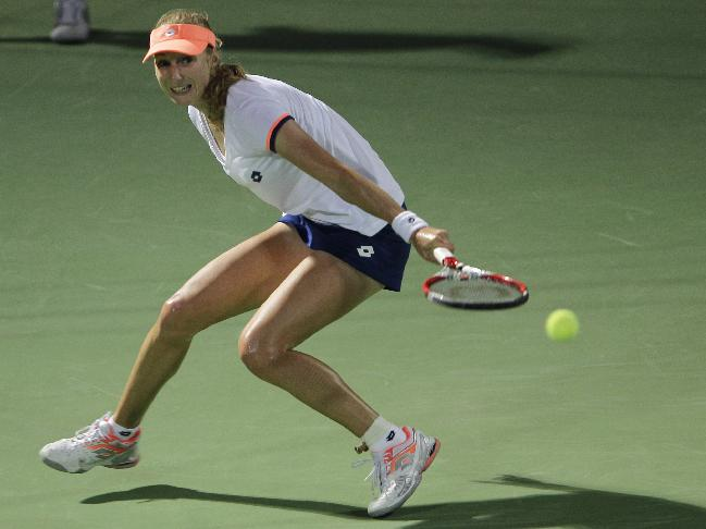 Ekaterina Makarova of Russia returns the ball to Serena Williams of the U.S. during the second round of Dubai Duty Free Tennis Championships in Dubai, United Arab Emirates, Tuesday, Feb. 18, 2014