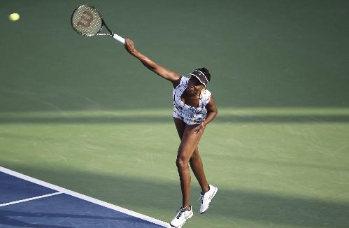 Venus Williams of the U.S. serves the ball to Ana Ivanovic of Serbia during the third day of Dubai Duty Free Tennis Championships in Dubai, United Arab Emirates, Wednesday, Feb. 19, 2014
