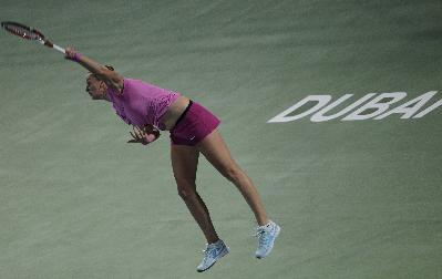 Petra Kvitova of the Czech Republic serves the ball to Carla Suarez Navarro of Spain during the third day of the Dubai Duty Free Tennis Championships in Dubai, United Arab Emirates, Wednesday, Feb. 19, 2014