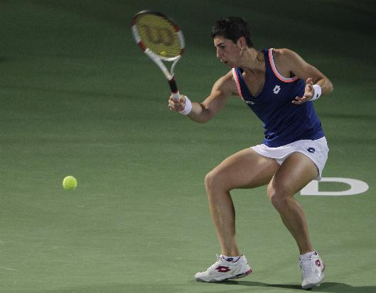 Carla Suarez Navarro of Spain returns to Petra Kvitova of Czech during the third day of the Dubai Duty Free Tennis Championships in Dubai, United Arab Emirates, Wednesday, Feb. 19, 2014
