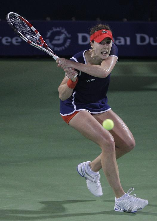 Alize Cornet of France returns the ball to Serena Williams of the U.S. during a semi final match of Dubai Duty Free Tennis Championships in Dubai, United Arab Emirates, Friday, Feb. 21, 2014