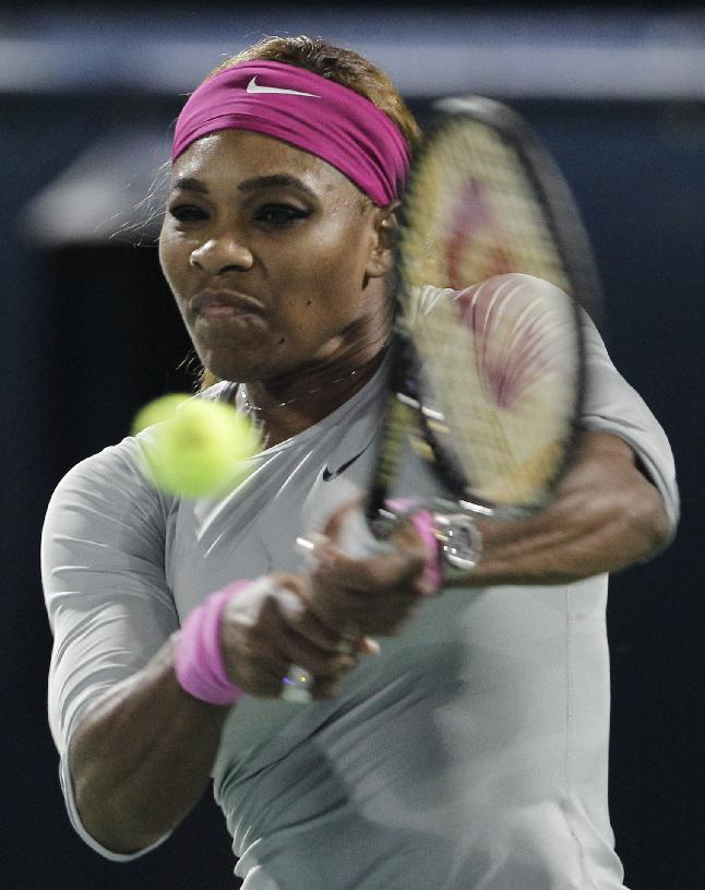 Serena Williams of the U.S. returns the ball to Alize Cornet of France during a semi final match of Dubai Duty Free Tennis Championships in Dubai, United Arab Emirates, Friday, Feb. 21, 2014