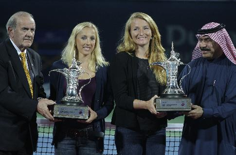Alla Kudryavtseva of Russia, right, and Anastasia Rodionova of Australia, hold  trophys after they beat Abigail Spears and Raquel Kops-Jones of the U.S. in the doubles final match of Dubai Duty Free Tennis Championships in Dubai, United Arab Emirates, Saturday, Feb. 22, 2014