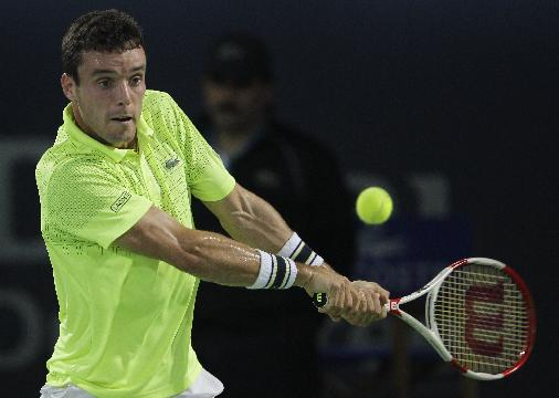 Spain's Roberto Bautista-Agut returns the ball to Novak Djokovic of Serbia during the third day of the Dubai Duty Free Tennis Championships in Dubai, United Arab Emirates, Wednesday, Feb. 26, 2014