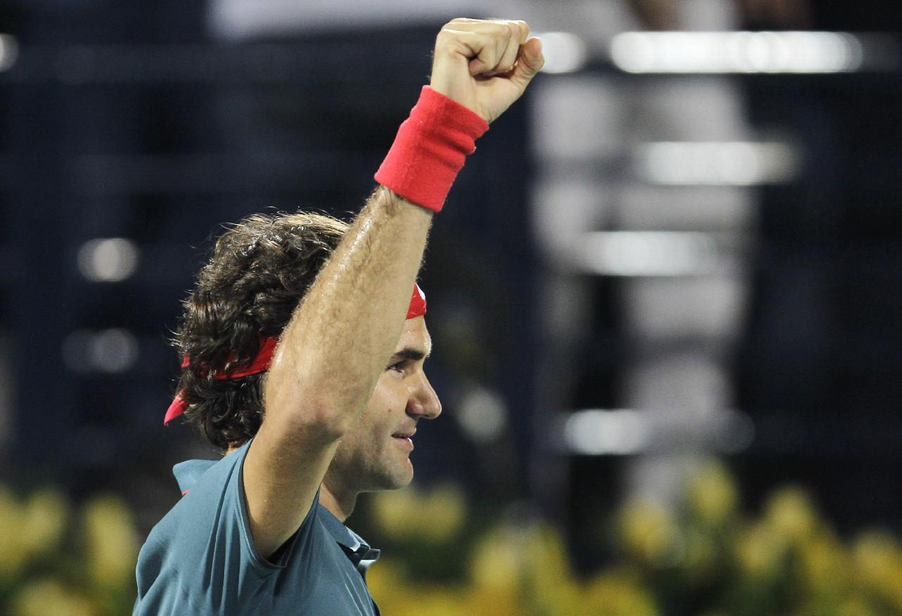 Roger Federer of Switzerland celebrates after he beats Novak Djokovic of Serbia during a semifinal match of the Dubai Tennis Championships in Dubai, United Arab Emirates, Friday, Feb. 28, 2014