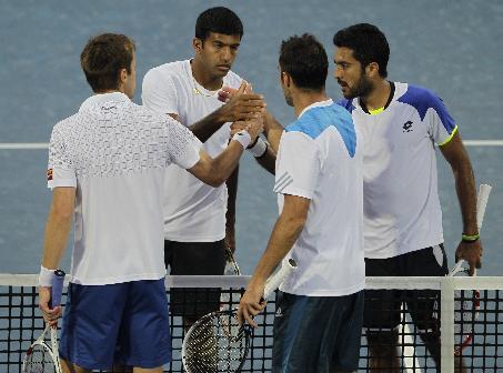 Rohan Bopanna of India, second left, and Aisam-Ul- Haq Qureshi of Pakistan, right, shakes hands with Daniel Nestor of Canada and Nenad Zimonjic of Serbia after Bopanna and Qureshi won the doubles final match of the Dubai Duty Free Tennis Championships in Dubai, United Arab Emirates, Saturday, March 1, 2014