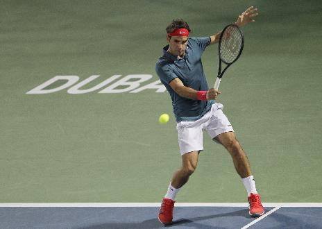 Roger Federer of Switzerland returns the ball to Tomas Berdych of Czech Republic during the final match of the Dubai Duty Free Tennis Championships in Dubai, United Arab Emirates, Saturday, March 1, 2014