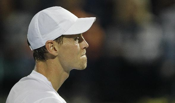 Tomas Berdych of Czech Republic reacts after he lost a point against Roger Federer of Switzerland, during the final match of the Dubai Duty Free Tennis Championships in Dubai, United Arab Emirates, Saturday, March 1, 2014