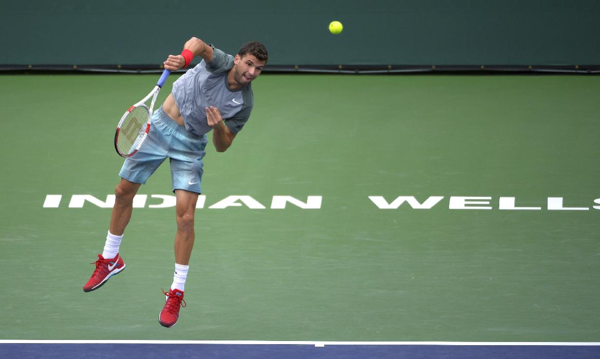 Grigor Dimitrov, of Bulgaria, serves to Ernests Gulbis, of Latvia, at the BNP Paribas Open tennis tournament, Tuesday, March 11, 2014, in Indian Wells, Calif