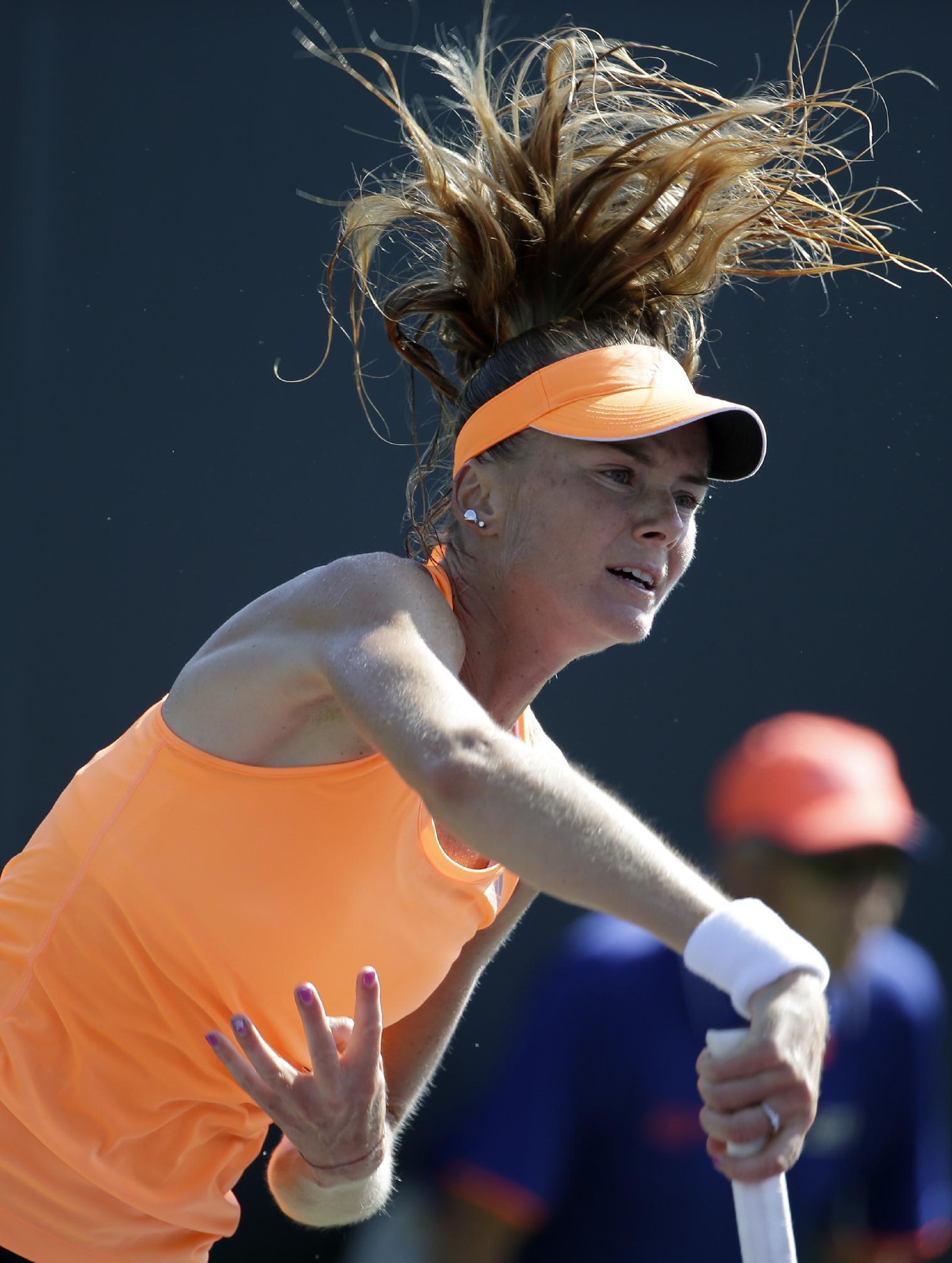 Daniela Hantuchova, of Slovakia, serves to Madison Keys at the Sony Open tennis tournament, Friday, March 21, 2014, in Key Biscayne, Fla. Keys won the match 6-4, 6-2
