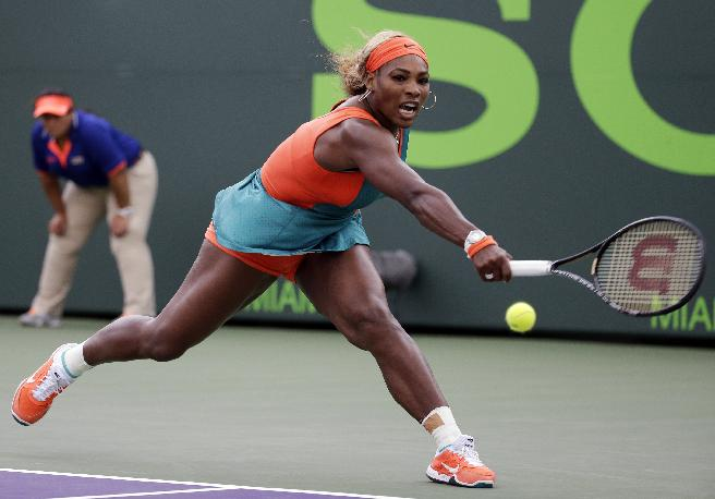 Serena Williams returns to Coco Vandeweghe at the Sony Open tennis tournament, Monday, March 24, 2014, in Key Biscayne, Fla