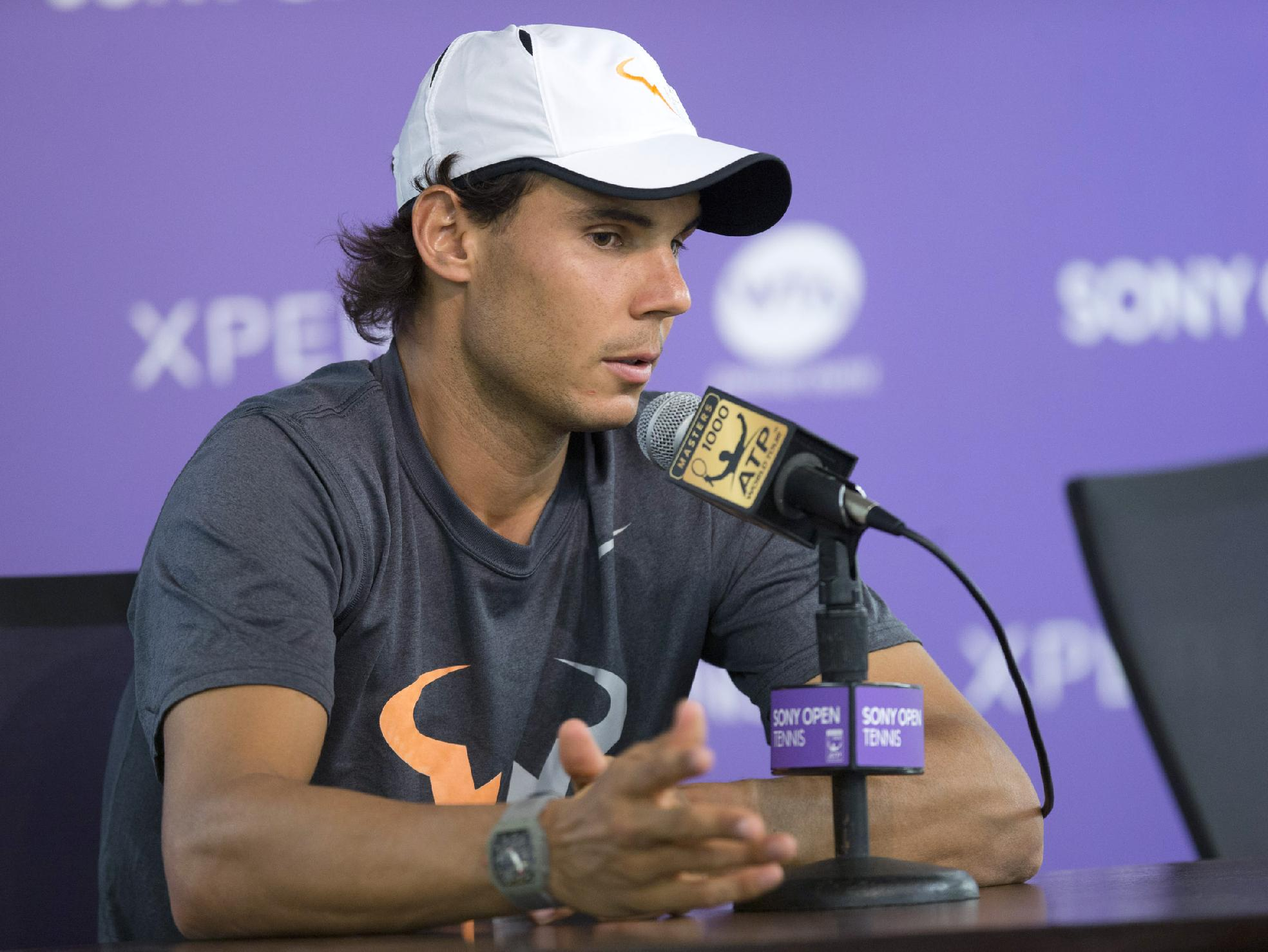 Rafeal Nadal, of Spain, talks to reporters at the Sony Open tennis tournament in Key Biscayne, Fla., Friday, March 28, 2014, after Tomas Berdych withdrew before their match for health reasons