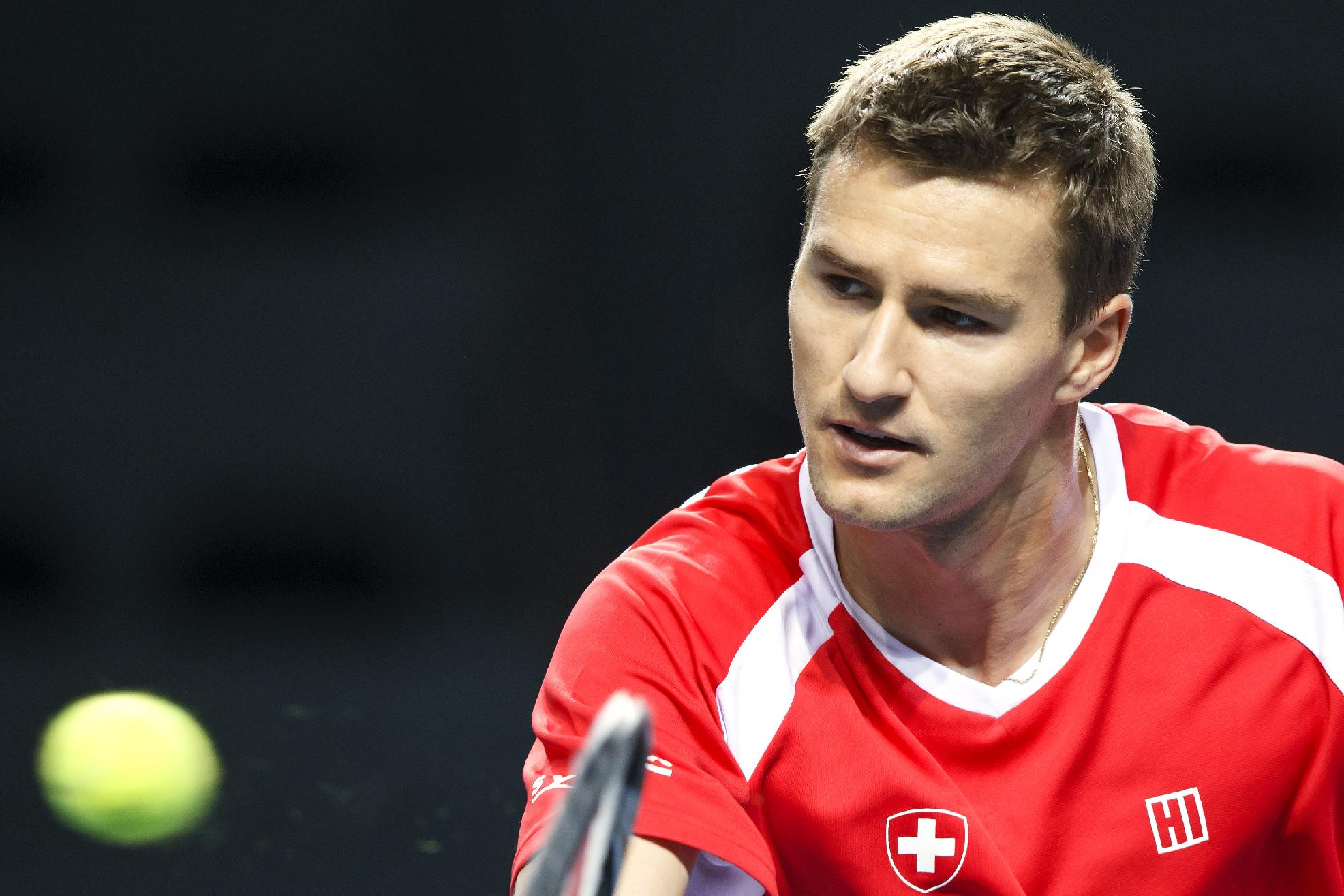 Marco Chiudinelli, of Switzerland, returns a ball, during a training session of the Swiss Davis Cup tennis team prior to the Davis Cup World Group quarterfinal match between Switzerland and Kazakhstan, in Geneva, Switzerland, Wednesday, April 2, 2014. The Davis Cup World Group quarterfinal  between Switzerland and  Kazakhstan will take place from April 4 to April 6