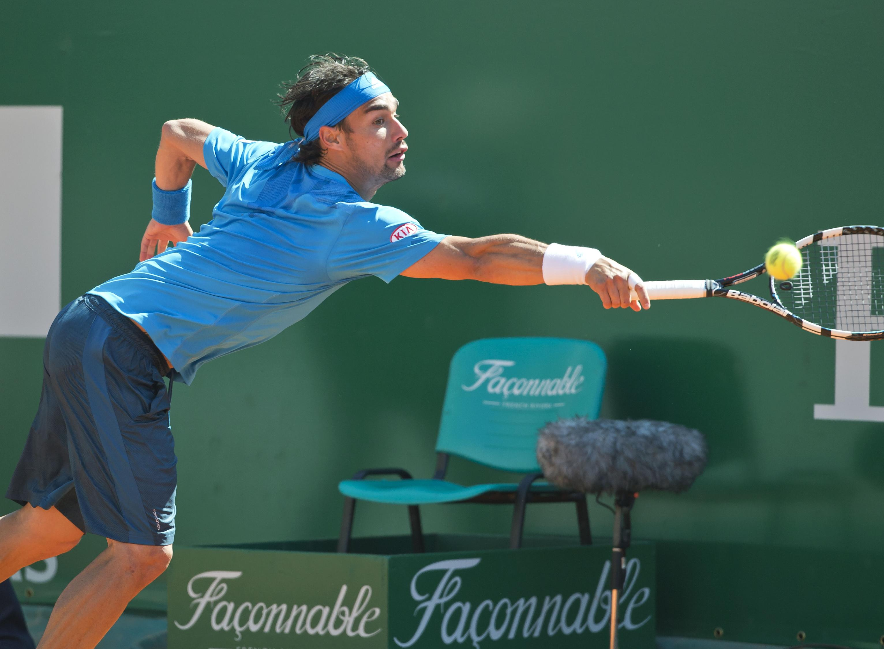 Fabio Fognini of Italy, returns the ball to Jo-Wilfried Tsonga of France during their third round match of the Monte Carlo Tennis Masters tournament in Monaco, Thursday, April 17, 2014. Tsonga won 5-7 6-3 6-0