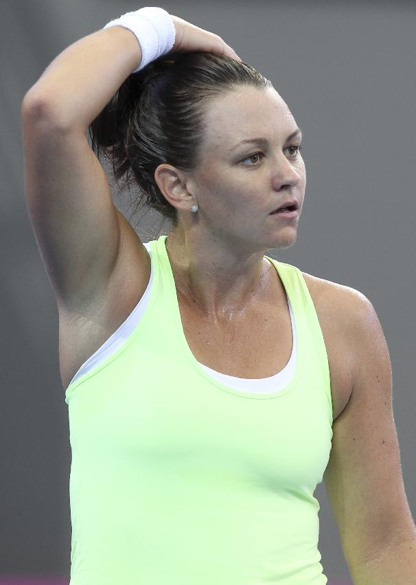 Casey Dellacqua of Australia reacts after missing a shot in her match against Angelique Kerber of Germany during the Fed Cup semi-finals between Australia and Germany in Brisbane, Australia, Saturday, April 19, 2014