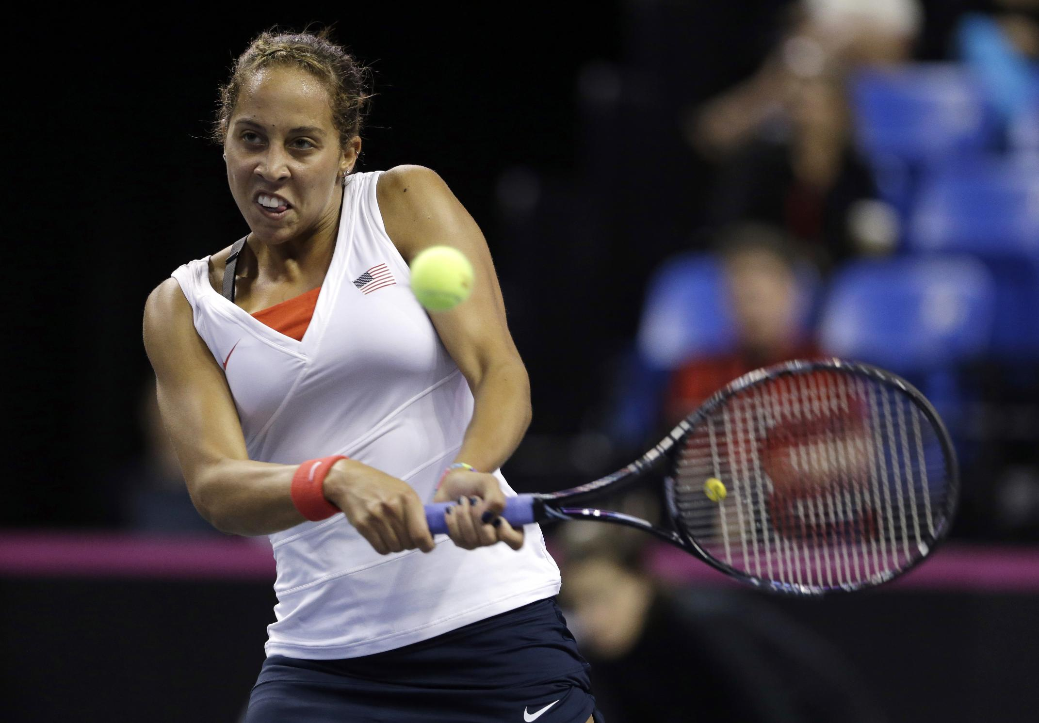 United States' Madison Keys returns the ball to France's Alize Cornet during a Fed Cup singles world group playoff tennis match Saturday, April 19, 2014, in St. Louis. Keys defeated Cornet 6-7 (4), 7-6 (4), 6-3