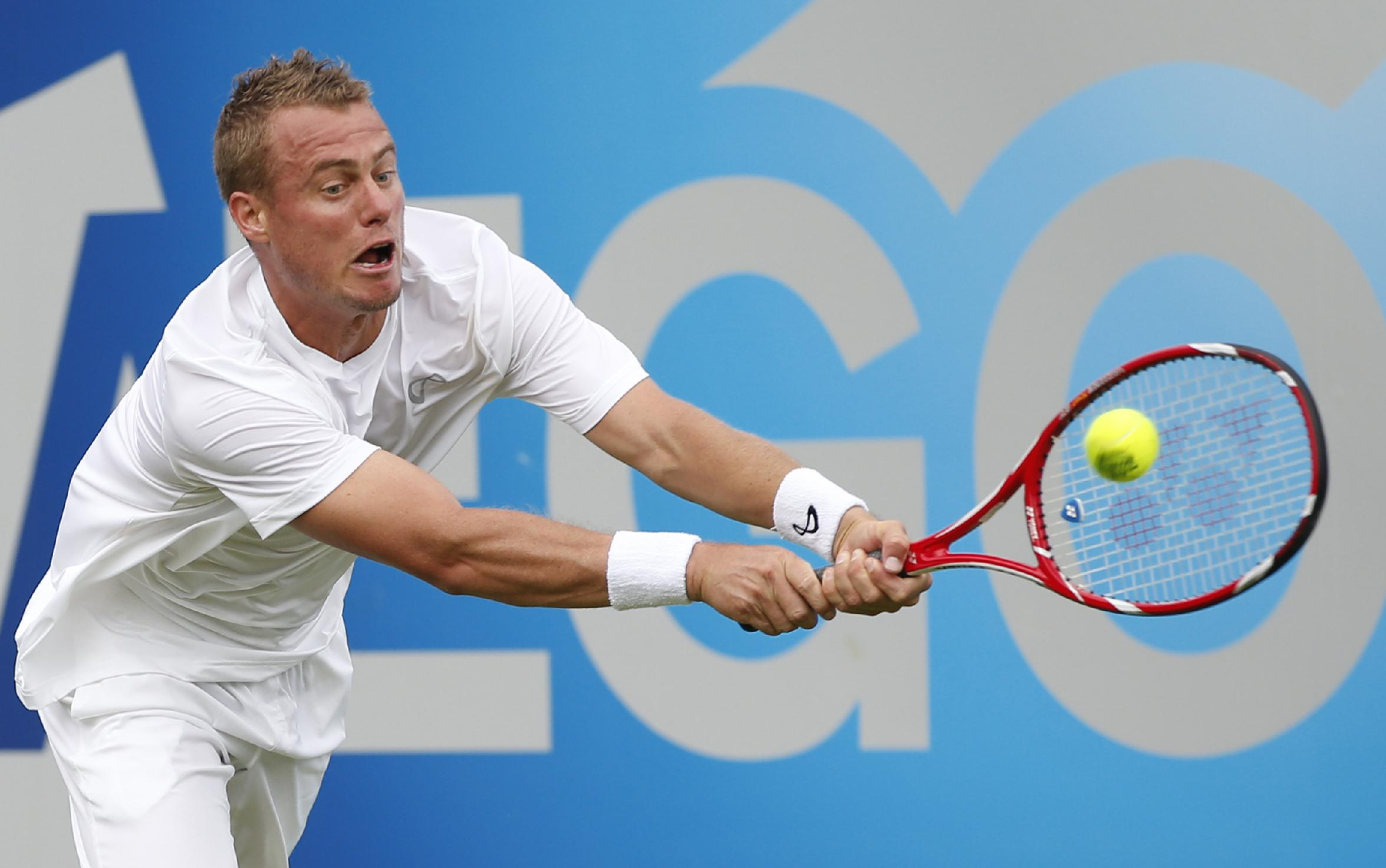Australia's Lleyton Hewitt plays a return to Daniel Gimeno-Traver of Spain during their first round at Queen's Club grass court tennis tournament match in London, Monday June 9, 2014