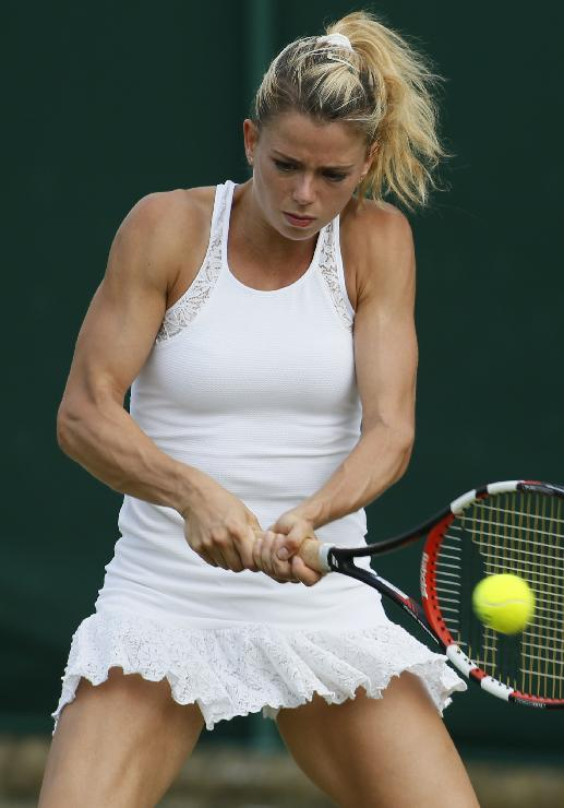 Camila Giorgi of Italy plays a return to Alison Riske of U.S. during their women's singles match at the All England Lawn Tennis Championships in Wimbledon, London, Thursday, June 26, 2014