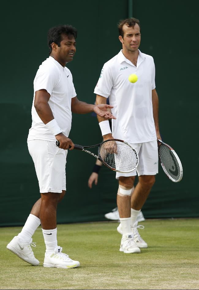 Laender Paes of India, left, and Radek Stepanek of the Czech Republic, right, talk between points during their men's doubles match against Mariusz Fyrstenberg of Poland and Rajeev Ram of the U.S. at the All England Lawn Tennis Championships in Wimbledon, London, Thursday, June 26, 2014