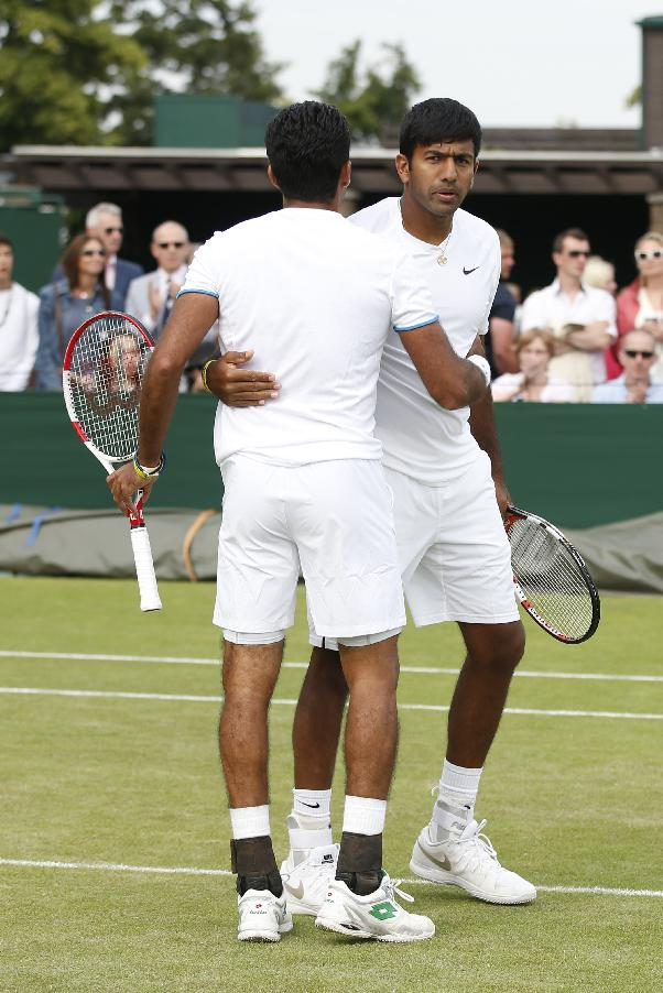 Rohan Bopanna of India, right, and Alsam Qureshi of Pakistan talk between points during their men's doubles match against Frantisek Cermak of Czech Republic and Mikhail Elgin of Russia at the All England Lawn Tennis Championships in Wimbledon, London, Thursday, June 26, 2014