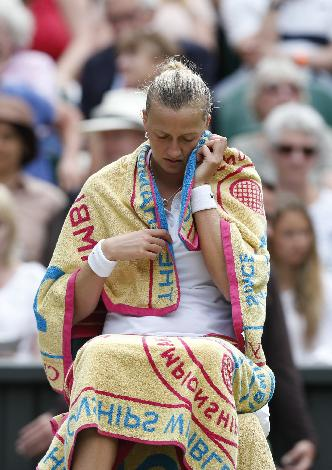 Petra Kvitova of Czech Republic rests between games against Venus Williams of U.S. during the women's singles match at the All England Lawn Tennis Championships in Wimbledon, London, Friday, June 27, 2014