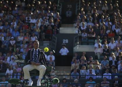 Umpire Mohamed Lahyani watches a tennis ball during the men's singles match between Alexandr Dolgopolov of Ukraine and Grigor Dimitrov of Bulgaria on Court No 1 at the All England Lawn Tennis Championships in Wimbledon, London, Friday June  27, 2014