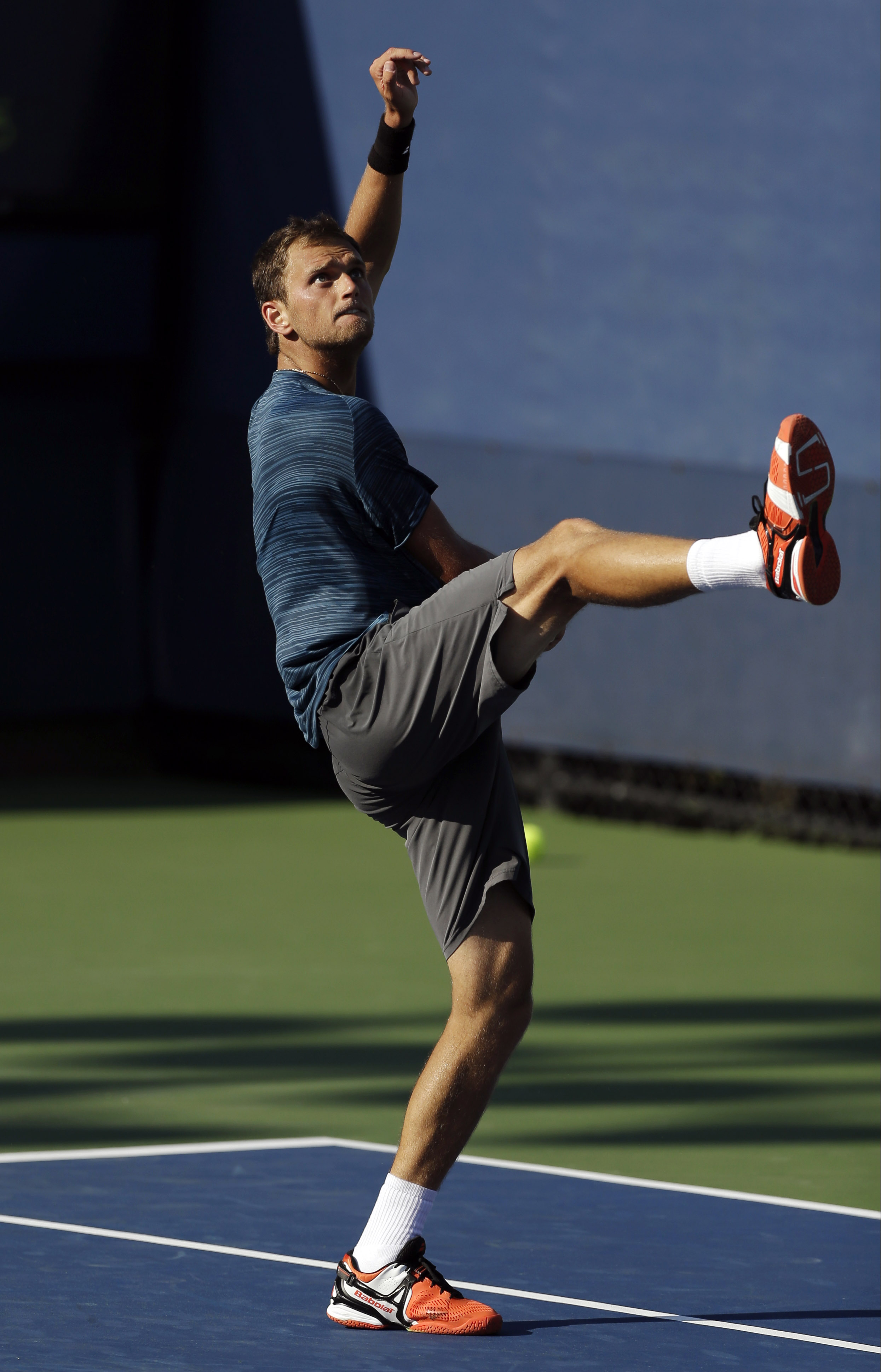 Edouard Roger-Vasselin, of France, reacts after a shot against Tommy Robredo of Spain during the opening round of the 2014 U.S. Open tennis tournament, Monday, Aug. 25, 2014, in New York