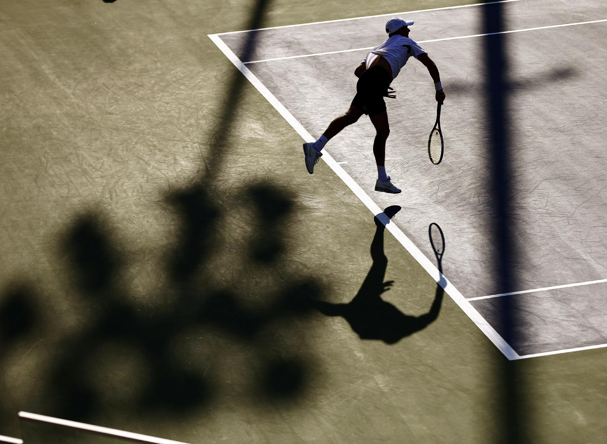 Edouard Roger-Vasselin, of France, serves against Tommy Robredo of Spain during the opening round of the 2014 U.S. Open tennis tournament, Monday, Aug. 25, 2014, in New York