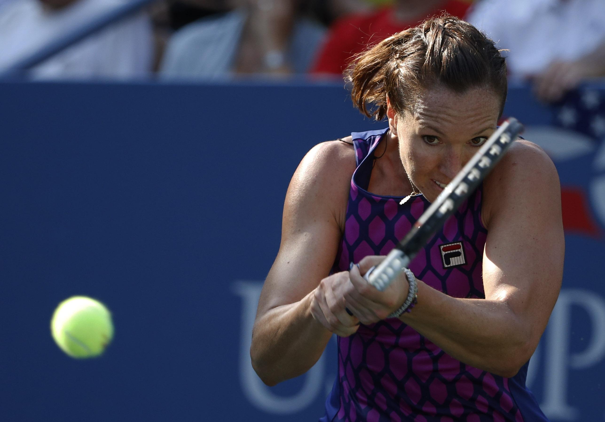 Jelena Jankovic, of Serbia, returns a shot against Tsvetana Pironkova, of Bulgaria, during the second round of the 2014 U.S. Open tennis tournament, Wednesday, Aug. 27, 2014, in New York