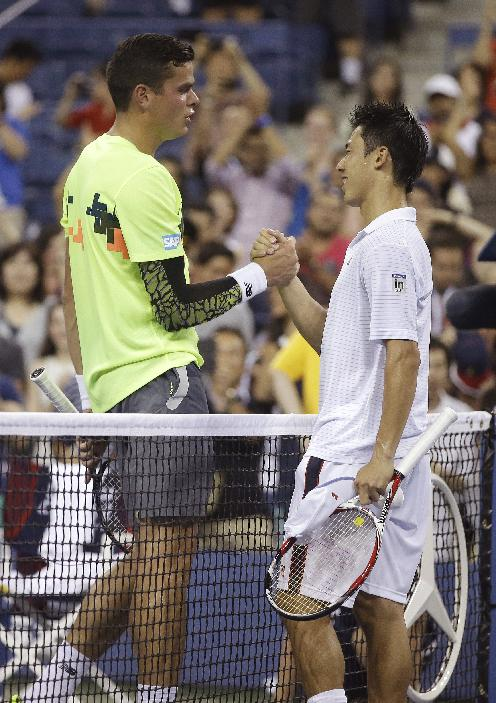 Kei Nishikori, of Japan, right, is congratulated by Milos Raonic, of Canada, after Nishikori defeated Raonic in the fourth round of the 2014 U.S. Open tennis tournament Tuesday, Sept. 2, 2014, in New York
