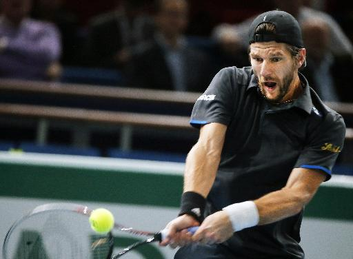 Jurgen Melzer of Austria returns the ball to Jo-Wilfried Tsonga of France during their second round match at the ATP World Tour Masters tennis tournament at Bercy stadium in Paris, France, Wednesday, Oct. 29, 2014