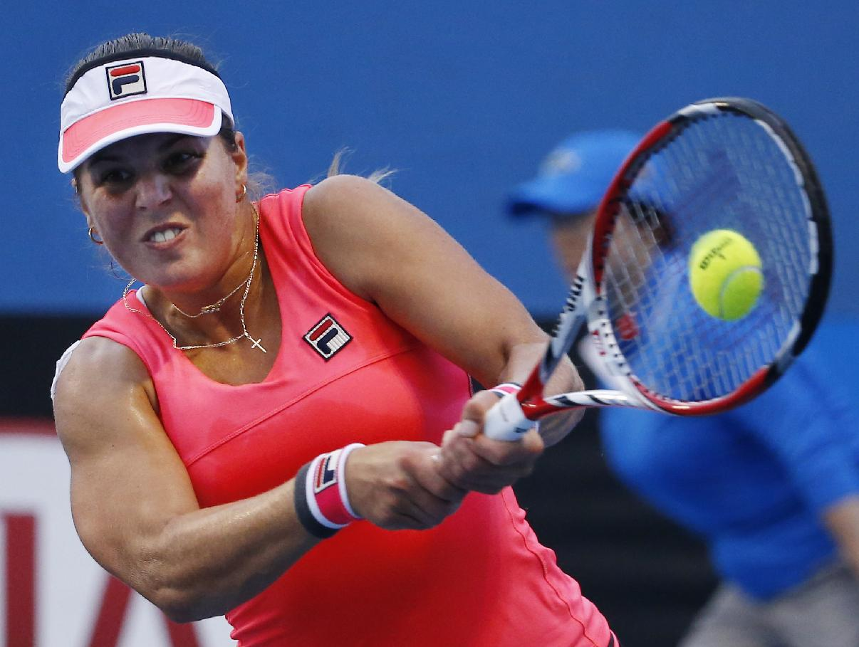 Anna Tatishvili of the U.S.  makes a backhand return to Kimiko Date-Krumm of Japan during their first round match at the Australian Open tennis championship in Melbourne, Australia, Tuesday, Jan. 20, 2015