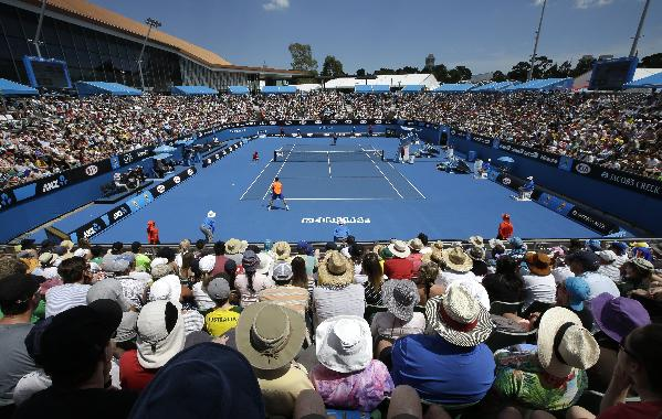 The spectators watch the second round match between Richard Gasquet of France and James Duckworth of Australia at the Australian Open tennis championship in Melbourne, Australia, Wednesday, Jan. 21, 2015