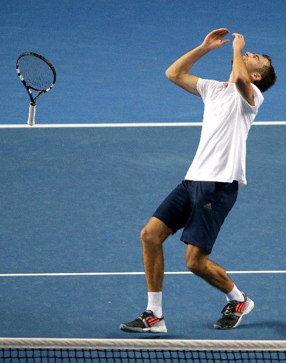 Jerzy Janowicz of Poland celebrates after defeating Gael Monfils of France during their second round match at the Australian Open tennis championship in Melbourne, Australia, Thursday, Jan. 22, 2015