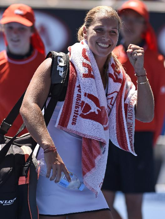 Dominika Cibulkova of Slovakia smiles when she leaves the court after defeating Alize Cornet of France in the third round match at the Australian Open tennis championship in Melbourne, Australia, Saturday, Jan. 24, 2015
