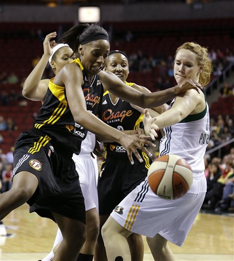 Tulsa Shock's Glory Johnson, left, and Seattle Storm's Chelsea Poppens reach for a loose ball in the second half of a preseason WNBA basketball game Friday, May 17, 2013, in Seattle. The Storm won 63-59
