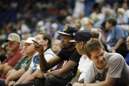 Oklahoma City Thunder forward Kevin Durant watches a play during an WNBA preseason basketball game between the Minnesota Lynx and Connecticut Sun, Tuesday, May 21, 2013, in Minneapolis. The Sun won 80-88. The Oklahoma City Thunder are giving $1 million for tornado relief, matching a $1 million pledge by star player Durant.  The Thunder announced Tuesday that they'll give $1 million to the American Red Cross, the Salvation Army and other disaster relief organizations helping after Monday's disaster in suburban Oklahoma City