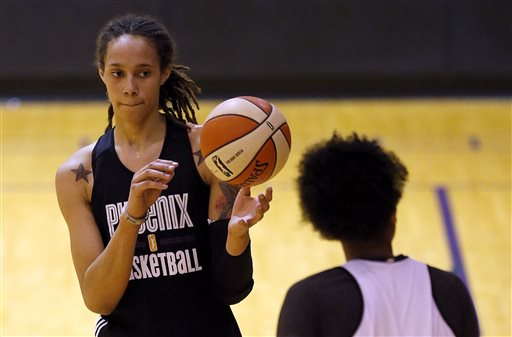 In this May 15, 2013 photo, Phoenix Mercury rookie center Brittney Griner, left, gets the ball from teammate Krystal Thomas during a WNBA team basketball practice in Phoenix