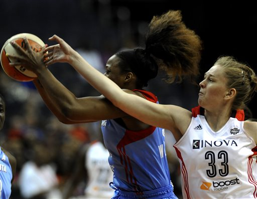 Atlanta Dream center Le'coe Willingham, left, grabs a rebound away from Washington Mystics center Emma Meesseman during a WNBA basketball game at the Verizon Center, Sunday, June 2, 2013, in Washington
