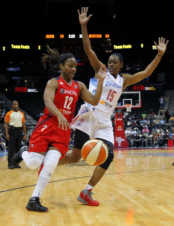 Washington Mystics guard Ivory Latta (12) drives against Atlanta Dream guard Tiffany Hayes (15) in Game 1 of an WNBA basketball Eastern Conference semifinals series, Thursday, Sept. 19, 2013, in Atlanta