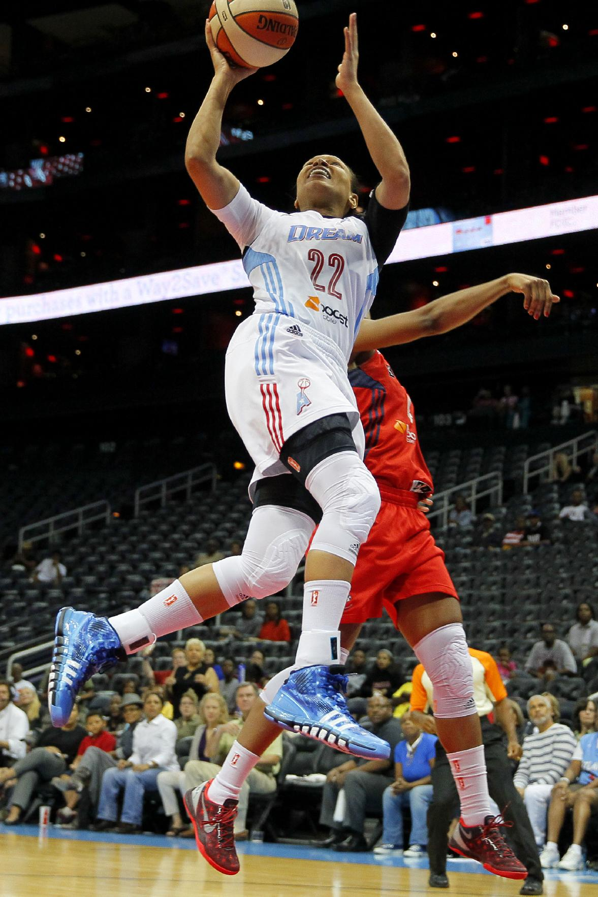 Atlanta Dream's Armintie Herrington (22) shoots against the Washington Mystics in the first quarter of Game 1 of a WNBA basketball Eastern Conference semifinals series, Thursday, Sept. 19, 2013, in Atlanta