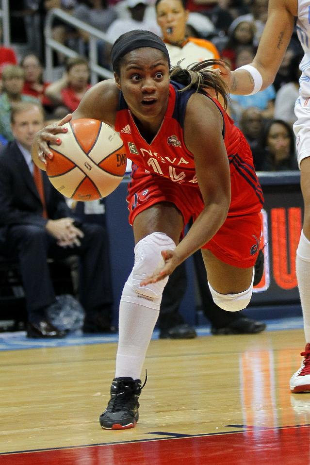 Washington Mystics guard Ivory Latta (12) drives to the basket in the fourth quarter in Game 1 against the Atlanta Dream of their WNBA basketball Eastern Conference semifinals playoff series, Thursday, Sept. 19, 2013, in Atlanta. The Mystics won 71-56
