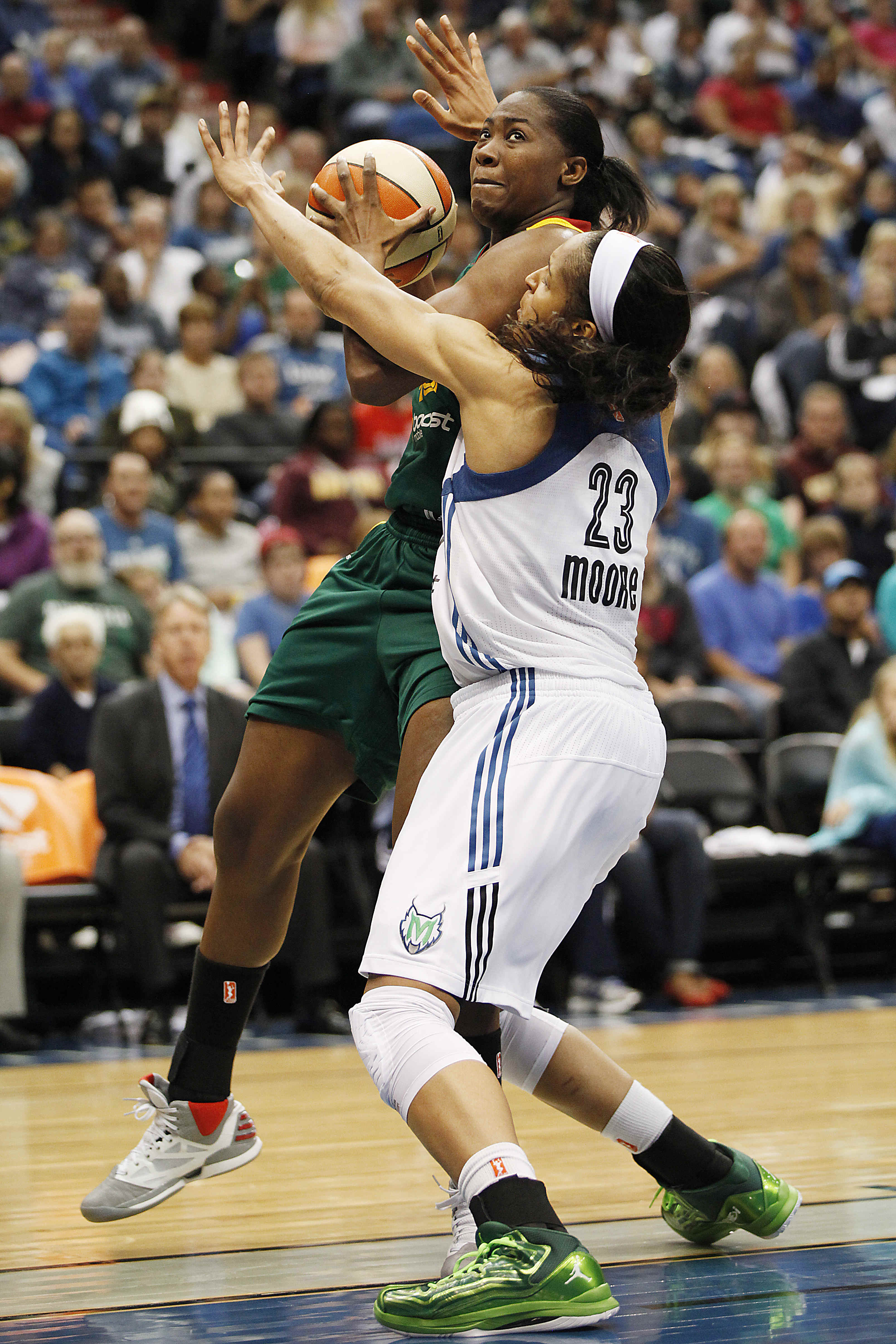 Seattle Storm guard SheKinna Stricklen pushes up to the basket against Minnesota Lynx guard Maya Moore (23) in the opening game of a first-round WNBA basketball playoff series, Friday, Sept. 20, 2013, in Minneapolis. The Lynx won 80-64