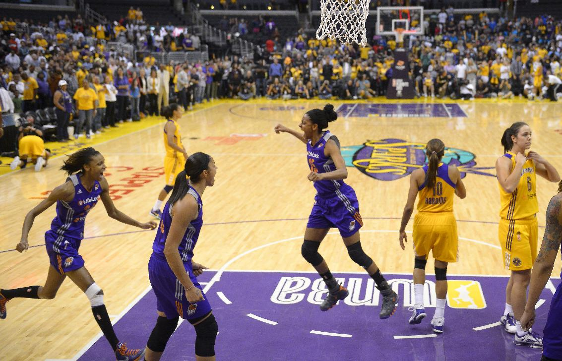 Phoenix Mercury forward DeWanna Bonner, left, and forward Candice Dupree, second from left, celebrate with Briana Gilbreath, center, as Los Angeles Sparks guard Lindsey Harding, second from left, and guard Jenna O'Hea look on after the Mecury defeated the Sparks in Game 3 of a WNBA basketball Western Conference semifinal series, Monday, Sept. 23, 2013, in  Los Angeles. The Mercury won 78-77