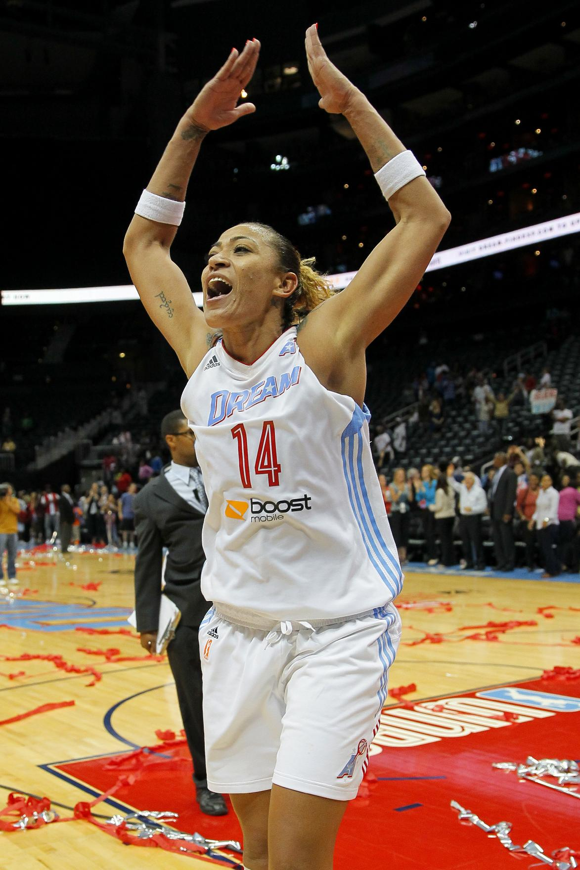 Atlanta Dream center Erika de Souza celebrates the Dream's 80-72 victory over the Washington Mystics in Game 3 of aWNBA basketball Eastern Conference semifinal series, Monday, Sept. 23, 2013, in Atlanta